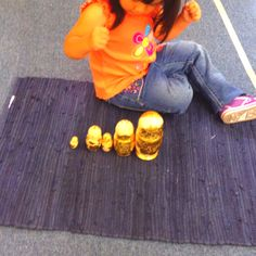 Toddler Montessori - nesting dolls in action. Trying to put them largest to smallest. Wonderful concentration
