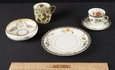 VINTAGE GROUPING OF PORCELAIN INCLUDES A HEAVY GILT FOOTED DRESDEN BOWL WITH HAND PAINTED FLOWER SWAG, A LIMOGES 7 INCH BREAD PLATE IN THE CLUNY PATTERN (TIGHT HAIRLINE) WITH MATCHING DEMITASSE CUP AND SAUCER AND A GERMAN MUSTACHE CUP WITH RIBBED BODY AND GOLD TRIM.