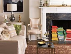 """15 Clever Ways to Decorate Your Non-Working Fireplace"" -- Shown: Color-coordinated books."