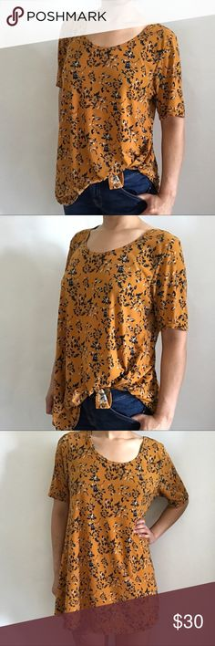 LuLaRoe Yellow Floral Simply Comfortable Blouse Beautiful condition LuLaRoe tunic in a mustard yellow color with floral print. This is a very versatile blouse. Wear it alone, with leggings or partially tucked in. No rips, stains or tears. Excellent condition, offers welcome! Bundle all your likes and save! LuLaRoe Tops Tunics