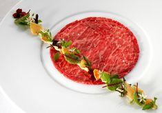 Wagyu beef carpaccio with vitello tonnato, confit shallot, gratin dauphinois.