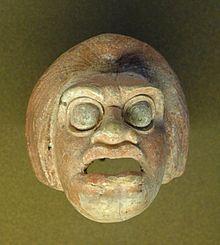 Théâtre grec antique — Wikipédia Masque de paysan - Tanagra
