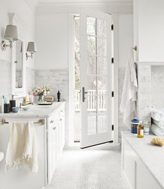 Carrara marble makes a big statement in the master bath, covering the walls, floor, and counters.