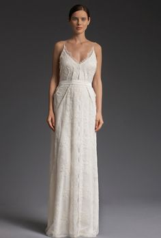 "Brides: Victoria Kyriakides. ""Love in Paris"" luxe urban wedding dress from embroidered lace, and a draped low back."