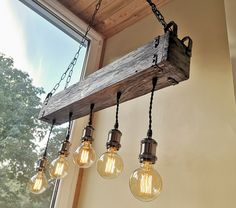 Tips And Ideas For Your Rustic Bathroom Project Rustic Lighting Diy, Rustic Lighting, Indoor Lighting, Wood Light, Ceiling Lights, Wood Beams, Wooden Chandelier, Rustic Chandelier, Diy Lighting