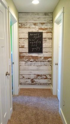 This wall! Perfect for the an alcove area or the end of a hallway. Love the reclaimed wood. Gorgeous!