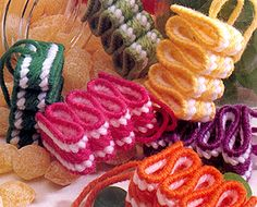Add a sweet touch to your Christmas tree with these colorful ornaments! Resembling old-fashioned ribbon candy in fruit flavors, these quick-to-stitch tree trimmers make novel decorations.They are stitched on a strip of 7 mesh plastic canvas x 89 thread Plastic Canvas Ornaments, Plastic Canvas Christmas, Plastic Canvas Crafts, Free Plastic Canvas Patterns, Plastic Craft, Plastic Canvas Stitches, Ribbon Candy, Mesh Ribbon, Plastic Mesh