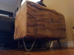slice of barn beam as side table