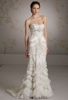 I just saw this yesterday on Say Yes to the Dress Atlanta, one of my guilty, postwork de-stress pleasures.  I always want MORE detail in a dress, its gorgeous!  The bride said she felt like a fish, but I love that!  Perhaps if it were taken down a few notches (and this runway version already has shorter/fewer ruffles and fewer appliques than rack version) the it would be perfect.  I wish it had a more flattering top for a larger bust, something with more support.  suggestions? ainosayuri