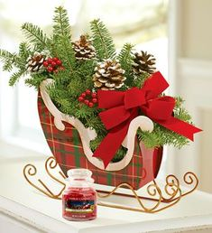 christmas sleigh filled with greenery - add tall candle Tartan Christmas, Christmas Art, Christmas Projects, Christmas Holidays, Christmas Wreaths, Christmas Ornaments, Christmas Flower Arrangements, Christmas Flowers, Christmas Centerpieces