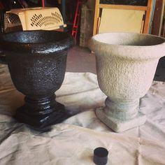 Spray paint plain cement urns for a richer, more expensive look. Under $20.00 at Lowes.