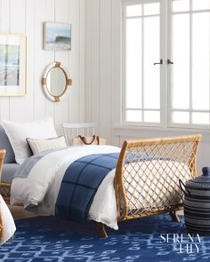 Specially washed eco-friendly cotton sateen makes for a playful white bedding in this coastal-inspired bedroom with a rattan bed, art gallery, and woven storage basket. Luxury Duvet Covers, Luxury Bedding, Modern Bedding, Blue And White Bedding, White Bedroom, Coastal Bedrooms, Coastal Living, Modern Coastal, Nautical Bedroom