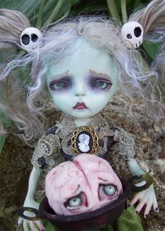 This is Dawn Dead.  She is a zombie girl. She is a posable soft body doll.  Her head, hands, and feet are made of polymer clay