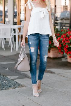 Paired this white linen top with my distressed skinny jeans. Perfect look for spring/summer!
