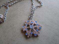 "Repurposed Vintage Snowflake Light Blue & Silver Rhinestone Brooch into Pendant Necklace, Silver 18"" Necklace. $25.00, via Etsy."