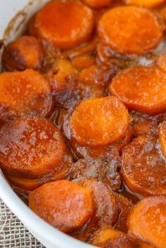 Candied Sweet Potatoes - An easy side dish recipe that tastes like a dessert. Tender sweet potato rounds are covered in a rich, buttery glaze. Candied Sweet Potatoes Mike Warfield Thanksgiving Candied Sweet Potatoes - An easy side dish reci Potato Dishes, Veggie Dishes, Food Dishes, Side Dishes Easy, Side Dish Recipes, Veggie Recipes Sides, Yam Recipes, Southern Side Dishes, Dishes Recipes