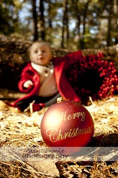 Idea for an outdoor photo with little kids.  Fun to focus on Christmas bulb and have child a little fuzzy.