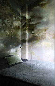 When exterior becomes interior: beautiful wall painting looks like a real forest in your bedroom.