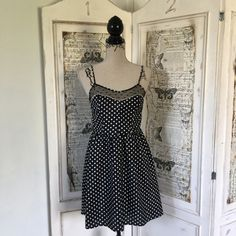 """Xhiliration polka dot dress Sz S Xhiliration polka dot dress Sz S has adjustable spaghetti straps, and elastic band around back for added stretch and comfort. Lace detail with black polka dots on front. Shell 100% polyester, lining 100% cotton. Measures 32"""" long Im front and 36"""" in back. Bust approx 32"""". Waist approx 28"""". Hips approx 40"""". #lisamariesvibe #polkadot #dress #flirty #feminine #daydate #dayshopping #daywithfriends #daytonignt #timeless #girly #classy #bridalshower #babyshower…"""