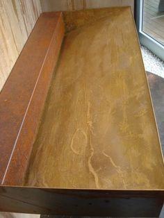 Lavabo in ferro tinteggiato ruggine e resina