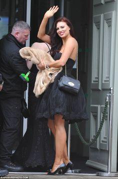 Bronzed beauty!Twinnie Lee Moore was showing off her brown legs in a short black dress