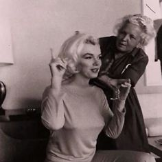 Agnes Flanagan fixing Marilyn Monroe's hair for a photo shoot with George Barris.