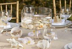 Pretty!  http://perfectweddings.info/ideas-for-unique-beach-theme-wedding-cakes-tips-on-beach-wedding-cake-decor/