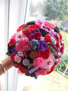 Wow, bright and colourful and perfect if you have a casino / Vegas wedding theme or would pack brilliantly if you are jetting off to marry in Vegas itself!  Can't believe how reasonably prices it is as well.    ---  Casino Las Vegas Button & Felt Bouquet £95.00, via Etsy.