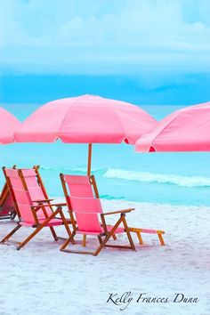 .Beach chairs and umbrellas, pretty in pink.