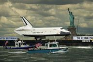 Enterprise Sails by the Statue of Liberty