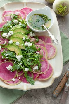 Watermelon Radish Carpaccio with Citrus Avocado Dressing - Watermelon radishes are shaved paper thin and dressed with a citrus avocado vinaigrette.