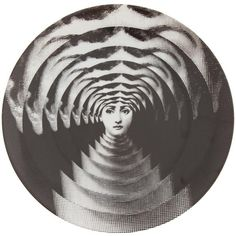Fornasetti Plate ($136) ❤ liked on Polyvore featuring home, home decor, wall art, black, black home decor, fornasetti plates, colored plates, black wall art and black porcelain plates