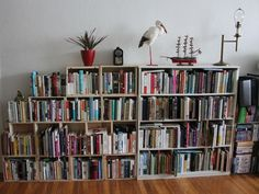 I am looking for an eclectic way to show off my book collection. I love the idea of mixing and matching bookshelves. Plus changing the direction of the books adds character, as do the personal pieces on top.