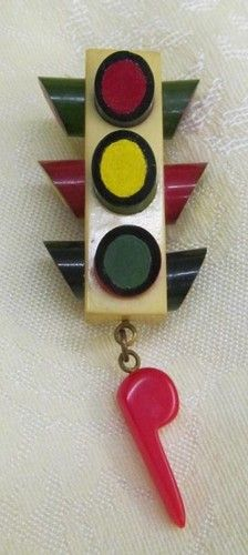 A charmingly fun vintage Bakelite  Stoplight Dangle Whistle Pin. #vintage #jewelry #brooches