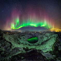 A colorful aurora over Iceland, also reflected in the central crater lake of the volcano, captured from the top of the caldera. Credit Sigurdur William Brynjarsson When the astrophotographer realized that aurora were visible two-weeks ago, he made Aurora Borealis, Venus E Marte, Landscape Photography, Nature Photography, Night Photography, Landscape Photos, Travel Photography, Ciel Nocturne, Astronomy Pictures