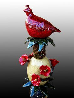 A Totem with Red Bird & Ceramic Flowers