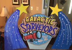 Logo & shooting stars standees made from blue foam insulation.
