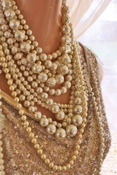 Why Don't You…pile on strings of pearls like Coco Chanel. Love love love this look...