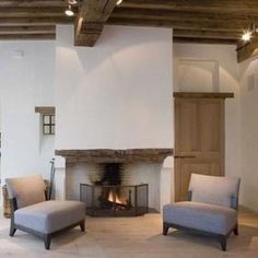 """42 Lovely Scandinavian Fireplace To Rock This Year. A stone fireplace design your pioneer ancestors would envy is the """"Multifunctional Fireplace."""" The hearth is built up high to create a storage a. Stucco Fireplace, Stone Fireplace Designs, Fireplace Mantels, Fireplaces, Mantle, Scandinavian Fireplace, Installing A Fireplace, Interior Architecture, Interior Design"""