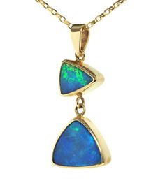 The pendant is made with two rich blue and green coloured opal doublets, made from high quality Australian natural opal. This pendant uses two settings to make an attractive jewellery piece. £580.00, https://www.rubymill.co.uk/double-setting-pendant-in-blue-and-green-12369