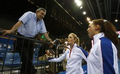 A relaxed Gordon Brown talks to British fencers Katy Livingston, centre, and Heather Fell at the fencing event of modern pentathlon at the Beijing Olympics