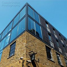 A088-06000_Modern_office_roof_extension_to_converted_factory_building_The_Borough_South_London_UK