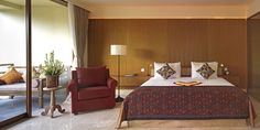 Book Komaneka At Rasa Sayang Ubud Hotel, Ubud, Bali. Members of ABTA. Ubud Bali Hotels, Boutiques, Resorts, Wooden Walls, Spa, Restaurant, Bedroom, Luxury, Table