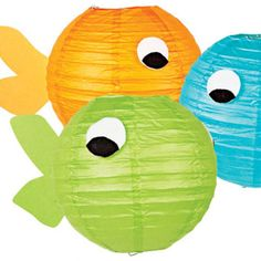 Sometimes the cutest ideas are also the simplest, like these paper lanterns dressed up to look like goldfish! They'd be adorable decor at any goldfish theme party, under the sea theme party, or pool party, don't you think? To make the fish lanterns, you cut the ...