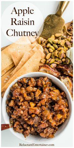 Make a batch of this Apple Raisin Chutney Recipe, delicious with meat, or as an appetizer paired with goat cheese, crackers, figs, and nuts! #applechutney #chutney #reluctantentertainer #appleraisinchutney
