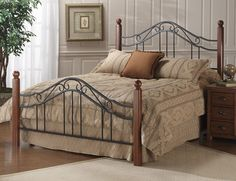 """The Madison's popular combination of wood and iron elements make this a great design. Square solid wood posts in a cherry finish are combined with textured black powder coated metal bed grills that feature round twisted wire spindles. Fully-welded construction featuring heavy gauge square tubing and solid wire.  Available as a Bed (Headboard and Footboard) in Twin, Full, Queen and King size; or HB only in Twin, Full/Queen and King size.HB height of 50.5"""" and FB height of 32.5.""""  Frame…"""