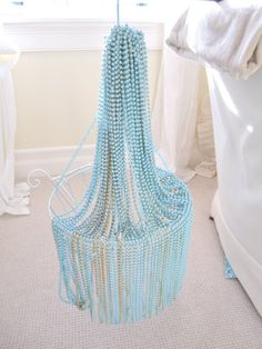 Beautiful DIY bead chandelier (different color pinks would be cute for a little girls room!)