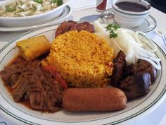 THE CRIOLLO:  Rice, Beans, Ropa Vieja, Fried Pork Chunks, Croquette, Plantains, Tamale and Cassava with Mojo | Versailles Restaurant in Miami