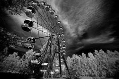 Ferris wheel - Prypiat city, Chernobyl #68 (infra red) The Pripyat amusement park was scheduled to open only four days after the Chernobyl accident, but this never happened. The ferris wheel, swings, bumper cars and the merry-go-round were never used and are now rusting away.