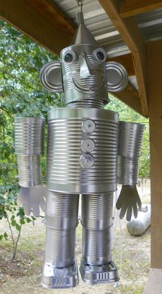 "My idea of a ""Tin Man"". The first one I made ~ I've gotten a little better at it now. $30~but can tell you the cans it take and how."
